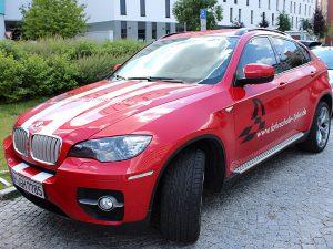 Fuhrpark - Fahrzeuge, Fahrschule 1plus, BMW X6 rot, Frontansicht