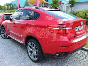 Fuhrpark - Fahrzeuge, Fahrschule 1plus, BMW X6 rot, Rückansicht